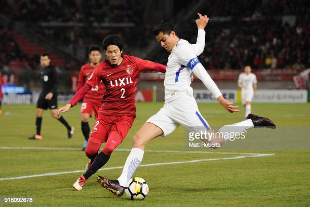Giovanni Moreno of Shanghai Shenhua and Atsuto Uchida of Kashima Antlers compete for the ball during the AFC Champions League Group H match between...