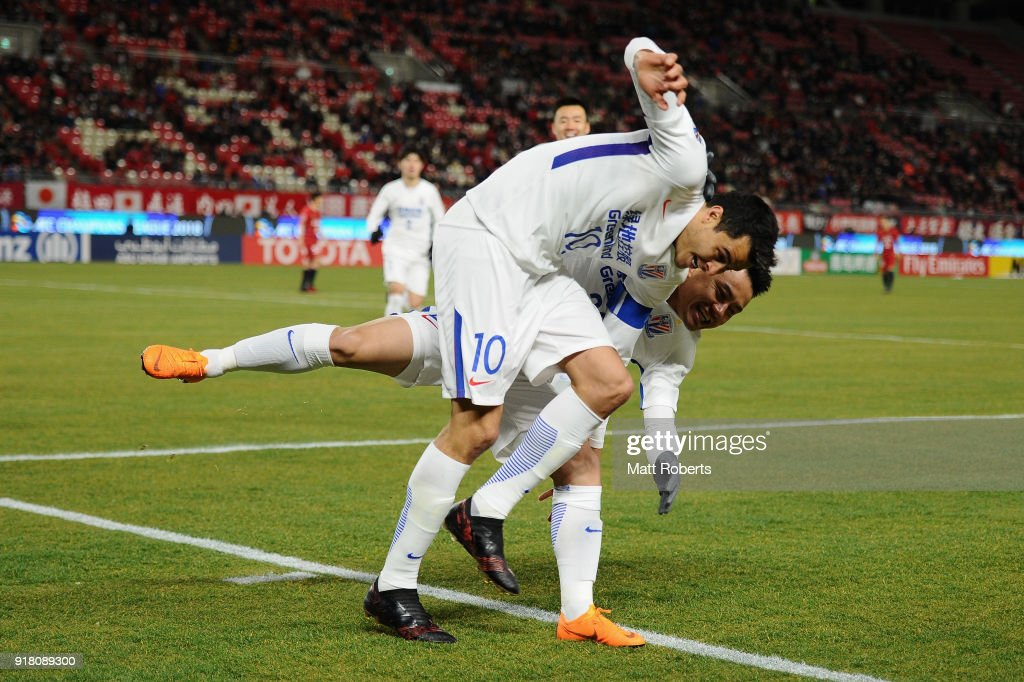 Giovanni Moreno (L) of Shanghai Shenhua celebrates scoring the opening goal with his team mate Cao Yunding (R) during the AFC Champions League Group H match between Kashima Antlers and Shanghai Shenhua at Kashima Soccer Stadium on February 14, 2018 in Kashima, Ibaraki, Japan.