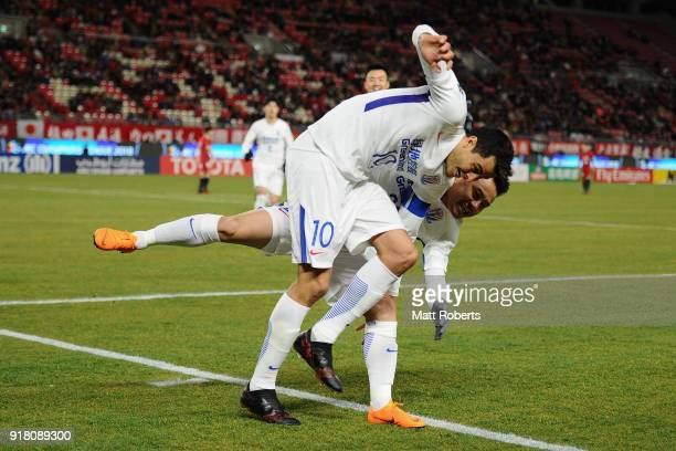 Giovanni Moreno of Shanghai Shenhua celebrates scoring the opening goal with his team mate Cao Yunding during the AFC Champions League Group H match...