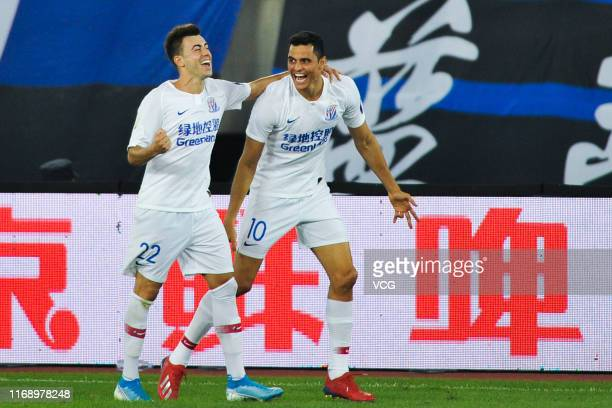 Giovanni Moreno of Shanghai Shenhua celebrates with Stephan El Shaarawy after scoring a goal during the 2019 Chinese Football Association Cup...