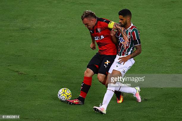 Giovanni of Fluminense struggles for the ball with Willian Farias of Vitoria during a match between Fluminense and Vitoria as part of Brasileirao...