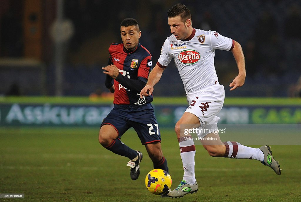 Giovanni Pasquale (R) of Torino FC in action against Matuzalem of Genoa CFC during the Serie A match between Genoa CFC and Torino FC at Stadio Luigi Ferraris on November 30, 2013 in Genoa, Italy.