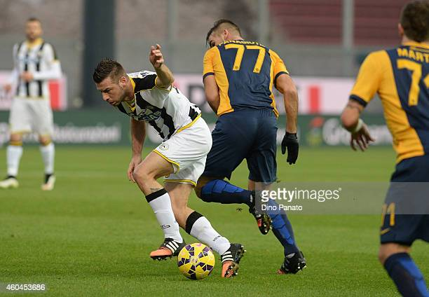 Giovanni Pasquale of Udinese Calcio battles for the ball with Panagiotis Tachtsidis of Hellas Verona during the Serie A match between Udinese Calcio...
