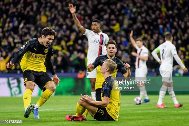 Giovanni Reyna Erling Haaland and Raphael Guerreiro celebrating Dortmunds first goal during the UEFA Champions League round of 16 first leg match...