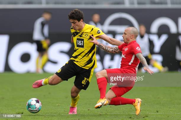 Giovanni Reyna of Borussia Dortmund and Angelino of RB Leipzig battle for the ball during the Bundesliga match between Borussia Dortmund and RB...