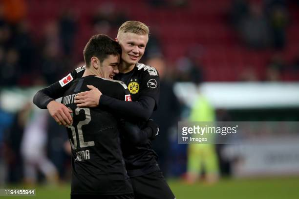 Giovanni Reyna of Borussia Dortmund and Erling Braut Haaland of Borussia Dortmund celebrate after winning the Bundesliga match between FC Augsburg...