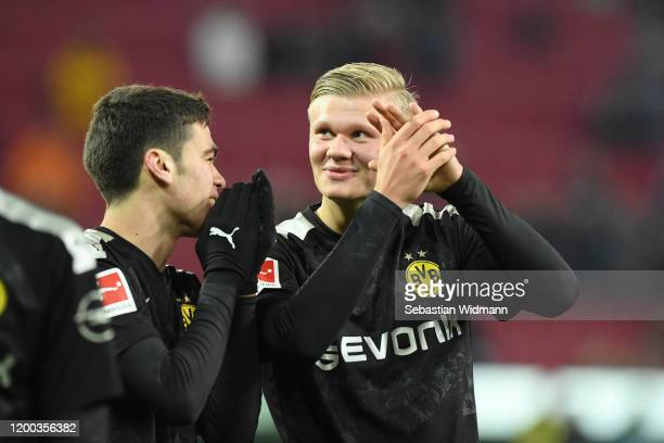 Giovanni Reyna of Borussia Dortmund and Erling Haaland of Borussia Dortmund celebrate after the Bundesliga match between FC Augsburg and Borussia...
