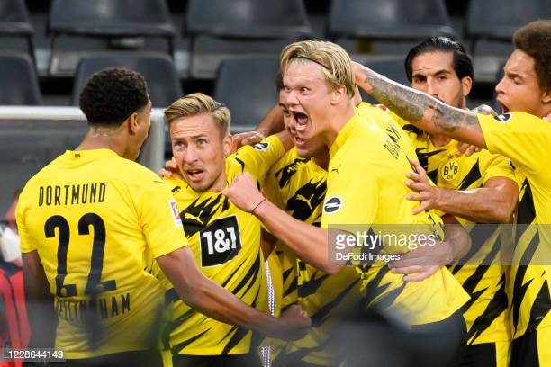 Giovanni Reyna of Borussia Dortmund celebrates after scoring his team's first goal with teammates during the Bundesliga match between Borussia...