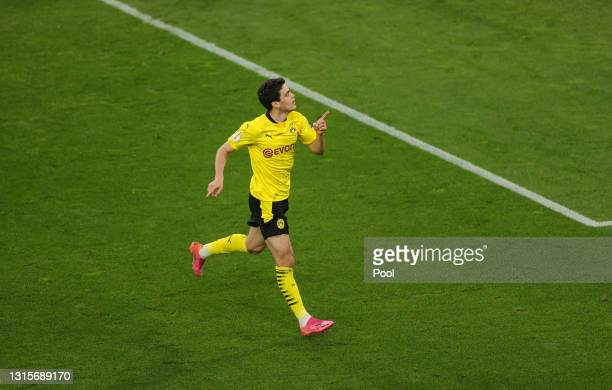 Giovanni Reyna of Borussia Dortmund celebrates after scoring their side's first goal during the DFB Cup semi final match between Borussia Dortmund...