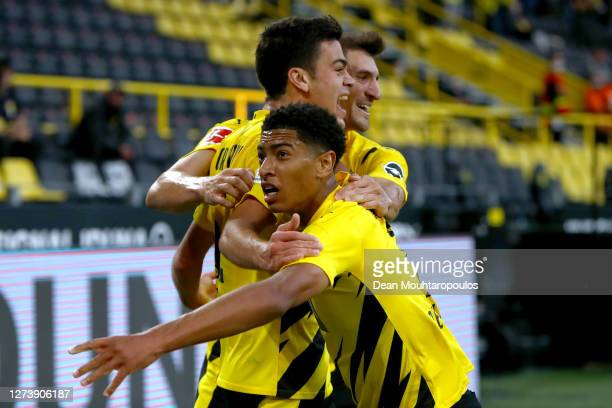 Giovanni Reyna of Borussia Dortmund celebrates scoring his teams first goal of the game with team mates Jude Bellingham and Thomas Meunier during the...