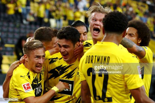 Giovanni Reyna of Borussia Dortmund celebrates scoring his teams first goal of the game with team mates Jude Bellingham Felix Passlack Erling Haaland...