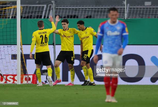 Giovanni Reyna of Borussia Dortmund celebrates with Lukasz Piszczek and Jude Bellingham after scoring their side's second goal during the DFB Cup...