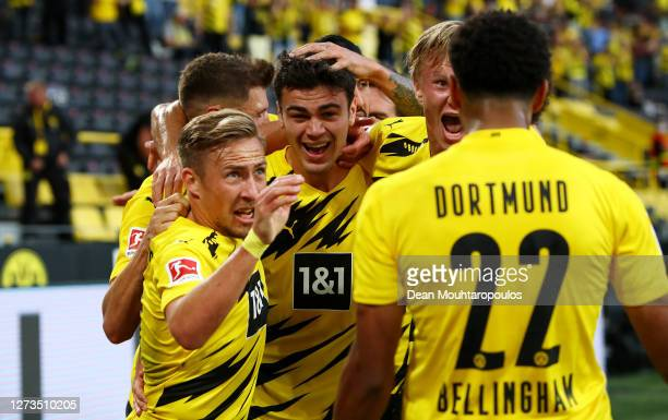 Giovanni Reyna of Borussia Dortmund celebrates with teammates after scoring his team's first goal during the Bundesliga match between Borussia...