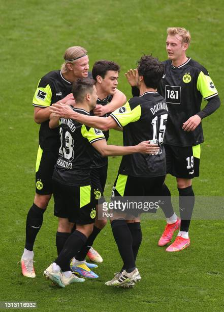 Giovanni Reyna of Borussia Dortmund celebrates with teammates after scoring their team's first goal during the Bundesliga match between Borussia...