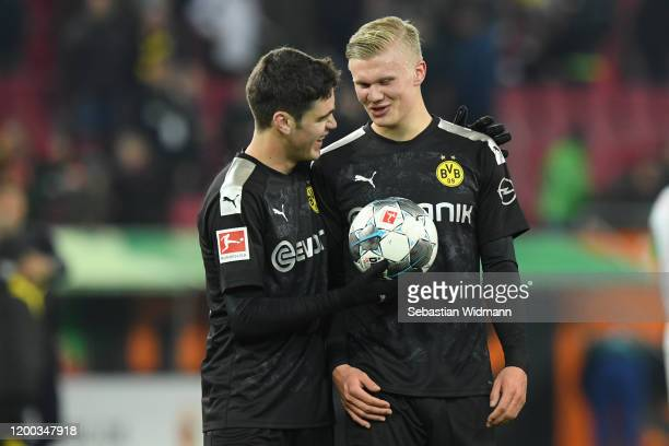 Giovanni Reyna of Borussia Dortmund hands the match ball to Erling Haaland of Borussia Dortmund after the Bundesliga match between FC Augsburg and...