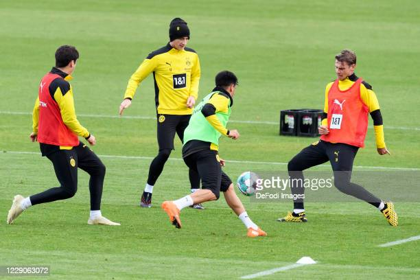 Giovanni Reyna of Borussia Dortmund Marco Reus of Borussia Dortmund Reinier of Borussia Dortmund and Lukasz Piszczek of Borussia Dortmund battle for...