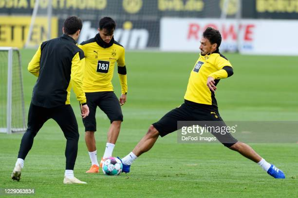 Giovanni Reyna of Borussia Dortmund Reinier of Borussia Dortmund and Mats Hummels of Borussia Dortmund battle for the ball during the Borussia...