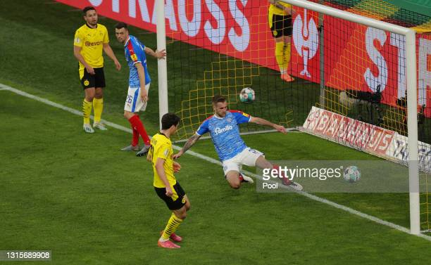 Giovanni Reyna of Borussia Dortmund scores their side's second goal during the DFB Cup semi final match between Borussia Dortmund and Holstein Kiel...