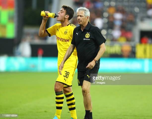 Giovanni Reyna of Borussia Dortmund speaks with head coach Lucien Favre of Borussia Dortmund during the preseason friendly match between Udinese...