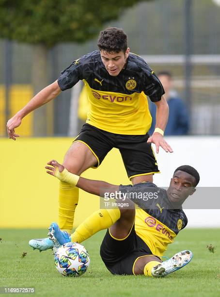 Giovanni Reyna of Borussia Dortmund U19 and Youssoufa Moukoko of Borussia Dortmund U19 controls the ball during the UEFA Youth League match between...