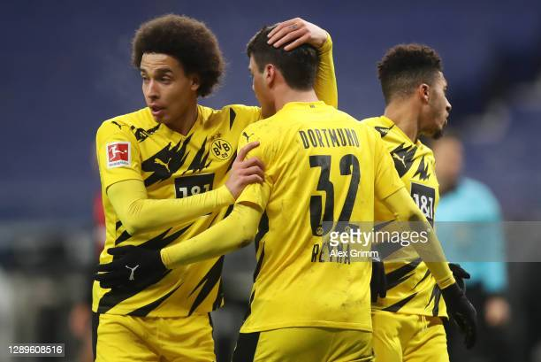 Giovanni Reyna of Dortmund celebrates his team's first goal with teammate Axel Witsel during the Bundesliga match between Eintracht Frankfurt and...