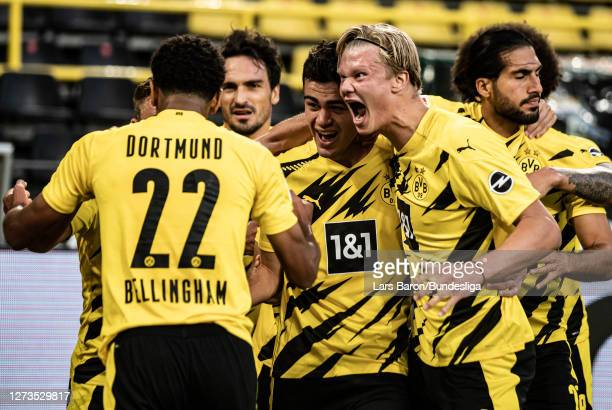 Giovanni Reyna of Dortmund celebrates with Jude Bellingham of Dortmund and Erling Haaland of Dortmund after scoring his teams first goal during the...