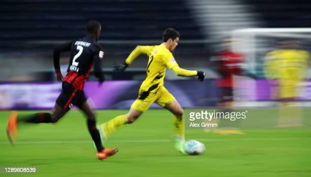 Giovanni Reyna of Dortmund eludes Evan N'Dicka of Frankfurt during the Bundesliga match between Eintracht Frankfurt and Borussia Dortmund at Deutsche...