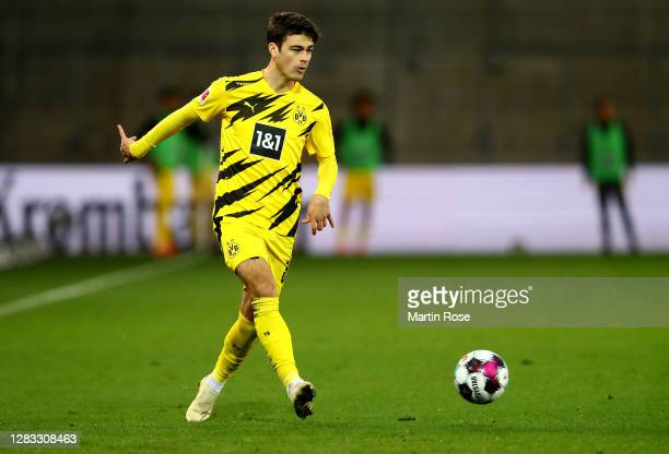 Giovanni Reyna of Dortmund runs with the ball during the Bundesliga match between DSC Arminia Bielefeld and Borussia Dortmund at Schueco Arena on...