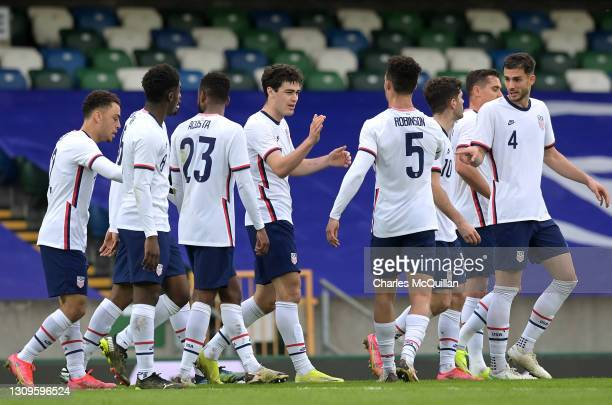 Giovanni Reyna of USA celebrates with Antonee Robinson and teammates after scoring their team's first goal during the International Friendly between...
