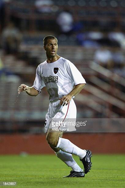 Giovanni Savarese of the New York/New Jersey MetroStars looks on against the Dallas Burn during the MLS game on March 5, 2003 at the Orange Bowl in...
