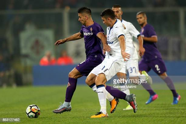 Giovanni Simeone of ACF Fiorentina battles for the ball with Mattia Caldara of Atalanta BC during the Serie A match between FC Crotone and Benevento...
