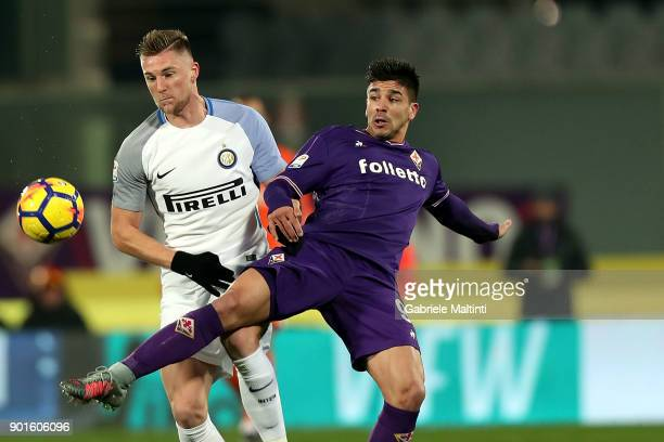 Giovanni Simeone of ACF Fiorentina battles for the ball with Milan Skriniar of FC Internazionale during the serie A match between ACF Fiorentina and...
