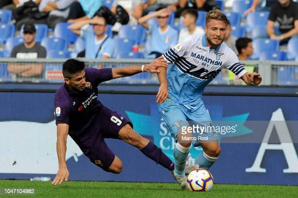 Giovanni Simeone of ACF Fiorentina compete for the ball with Ciro Immobile of SS Lazio during the Serie A match between SS Lazio and ACF Fiorentina...