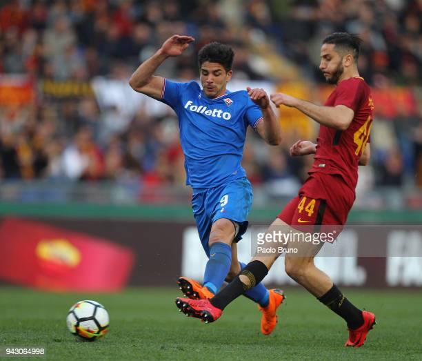 Giovanni Simeone of ACF Fiorentina competes for the ball with Kostas Manolas of AS Roma during the serie A match between AS Roma and ACF Fiorentina...