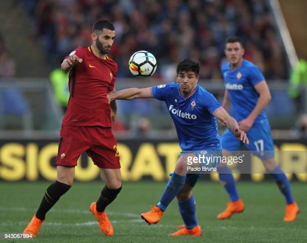 Giovanni Simeone of ACF Fiorentina competes for the ball with Maxime Gonalons of AS Roma during the serie A match between AS Roma and ACF Fiorentina...