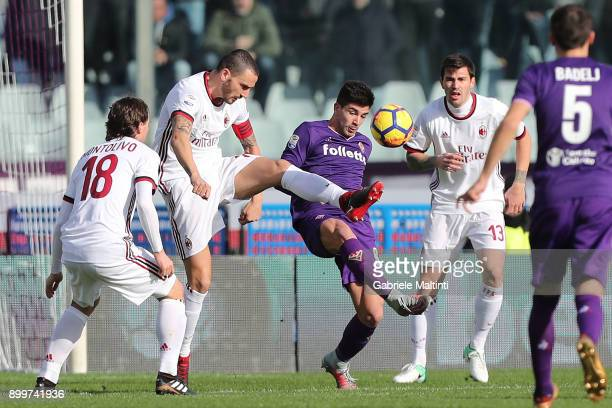 Giovanni Simeone of ACF Fiorentina fights for the ball with Leonardo Bonucci of AC Milan during the serie A match between ACF Fiorentina and AC Milan...
