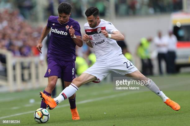Giovanni Simeone of ACF Fiorentina in action against Charalampos Lykogiannis of Cagliari Calcio during the serie A match between ACF Fiorentina and...