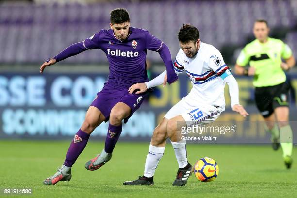Giovanni Simeone of ACF Fiorentina in action against Vasco Regini of US Sampdoria during the Tim Cup match between ACF Fiorentina and UC Sampdoria at...