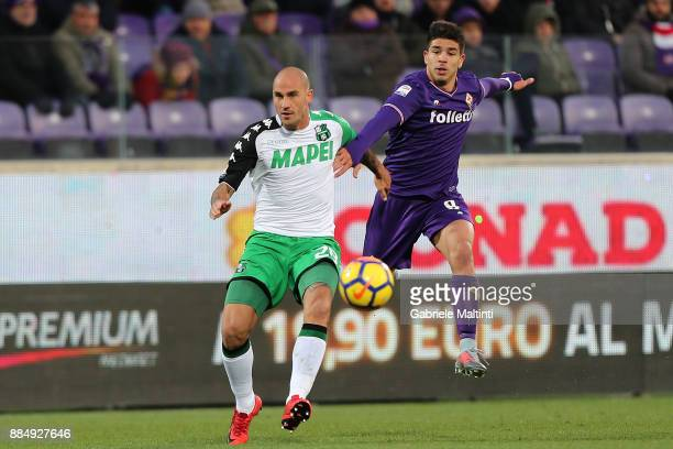 Giovanni Simeone of ACF Fiorentina in action agaist Paolo Cannavaro of US Sassuolo during the Serie A match between ACF Fiorentina and US Sassuolo at...