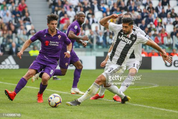 Giovanni Simeone of ACF Fiorentina is challenged by Emre Can of Juventus during the Serie A match between Juventus and ACF Fiorentina on April 20...
