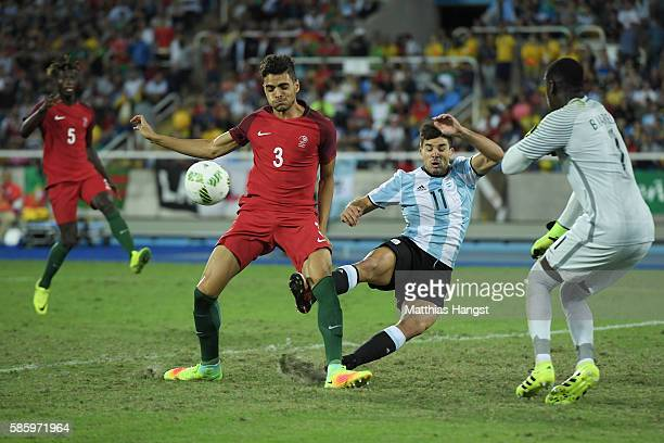 Giovanni Simeone of Argentina and Ilori Tiago of Portugal battle for the ball during the Men's Group D first round match between Portugal and...