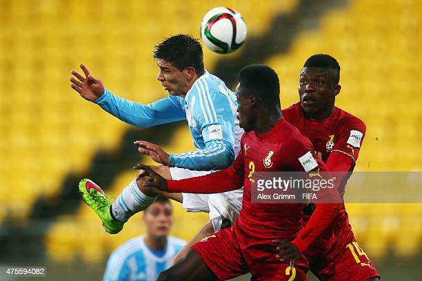 Giovanni Simeone of Argentina jumps for a header with Emmanuel Ntim and Joseph Aidoo of Ghana during the FIFA U20 World Cup New Zealand 2015 Group B...