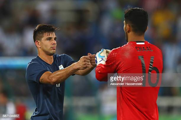 Giovanni Simeone of Argentina shake hands with Farid Chaal keeper of Algeria after the Men's Group D first round match between Argentina and Algeria...