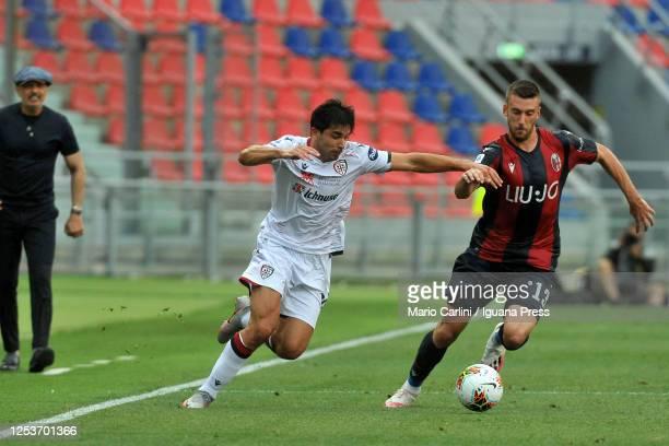 Giovanni Simeone of Cagliari Calcio competes the ball with Mattia Bani of Bologna FC during the Serie A match between Bologna FC and Cagliari Calcio...