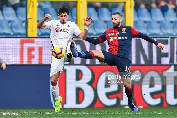 Giovanni Simeone of Fiorentina and Davide Biraschi of Genoa vie for the ball during the Serie A match between Genoa CFC and ACF Fiorentina at Stadio...