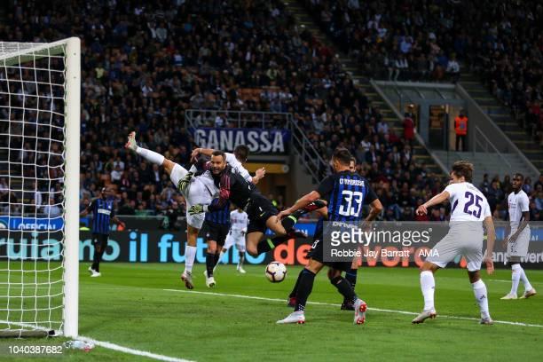 Giovanni Simeone of Fiorentina and Samir Handanovic of FC Internazionale during the Serie A match between FC Internazionale v ACF Fiorentina at...