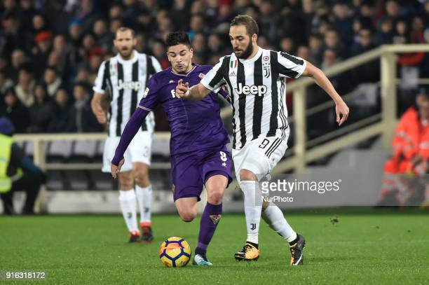 Giovanni Simeone of Fiorentina challenges Gonzalo Higuain of Juventus during the Serie A match between Fiorentina and Juventus at Stadio Artemio...