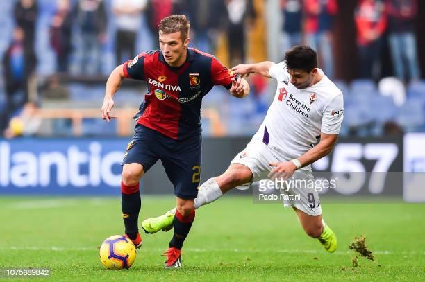 Giovanni Simeone of Fiorentina tackles Darko Lazovic of Genoa during the Serie A match between Genoa CFC and ACF Fiorentina at Stadio Luigi Ferraris...