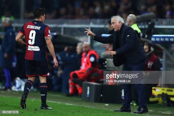 Giovanni Simeone of Genoa CFC receives instructions from coach Andrea Mandolini during the Serie A match between Genoa CFC and UC Sampdoria at Stadio...