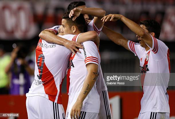 Giovanni Simeone of River Plate and teammates celebrate their team's second goal during a second leg match between River Plate and Libertad as part...